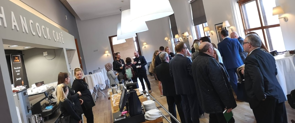 Members and guests networking over breakfast in the Hancock Cafe